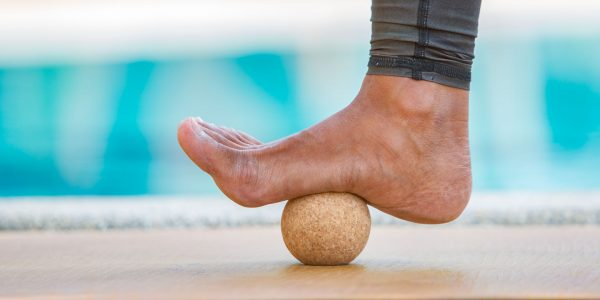 Cork acupressure ball used with foot